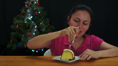 Woman Eating Christmas Cake Stock Video Footage