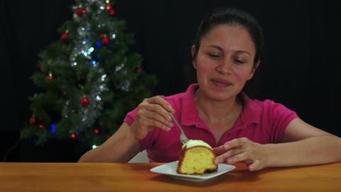 Woman Eating Christmas Cake Stock Video Footage