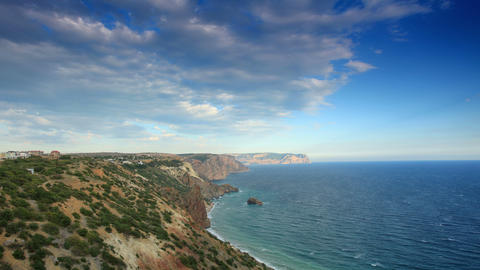 4K. Cloudy sky over the mountains and the sea. Cap Stock Video Footage