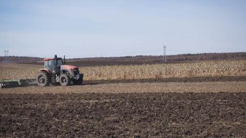 Tractor plowing the autumn field 01 Stock Video Footage