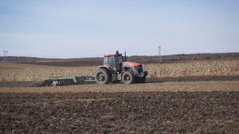 Tractor plowing the autumn field 01 Footage