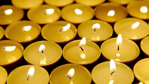 Candles background, prayer tea light candles Stock Video Footage