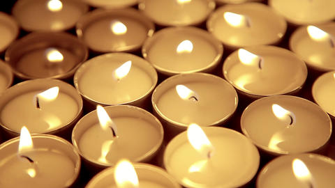 Candles background, prayer tea light candles Footage