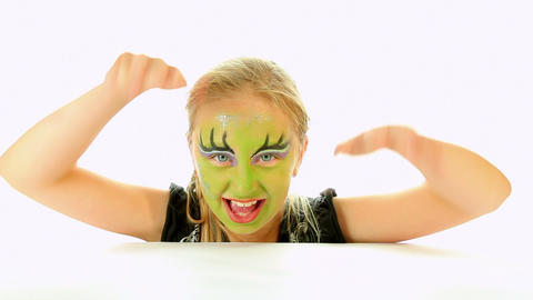 Scary little green girl for Halloween Footage