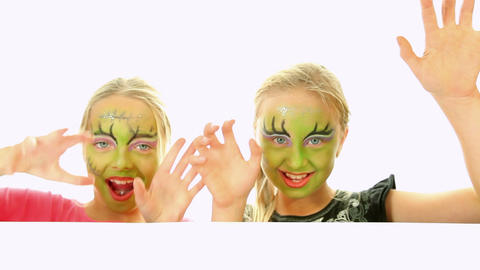Scary little green girls for Halloween Footage