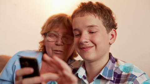 Young Boy and Old Person Learn Smartphone Stock Video Footage