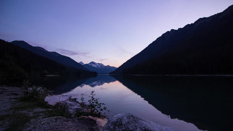 Motion time lapse day to night shot by a lake Stock Video Footage