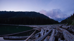 Twilight clouds at Duffey lake by the wood pile Stock Video Footage