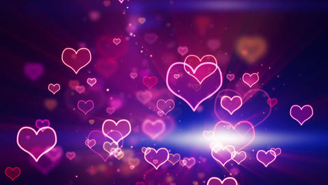 glowing neon hearts seamless loop background Stock Video Footage