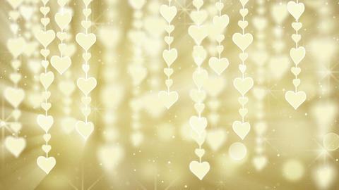 dangling gold hearts loop Stock Video Footage