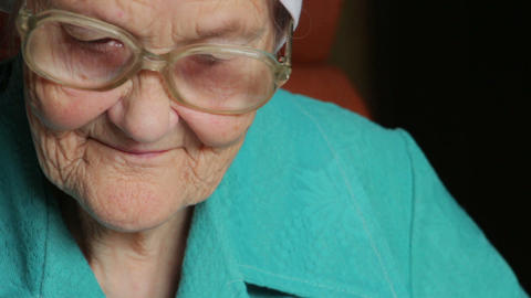 portrait of old reading woman in glasses Footage