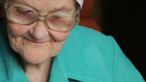 portrait of old reading woman in glasses Stock Video Footage