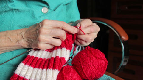 Closeup Of Old Womans Hands Knitting stock footage