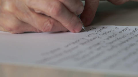 hand of old woman writing letter Stock Video Footage
