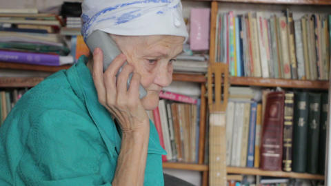 old woman talking on phone Stock Video Footage