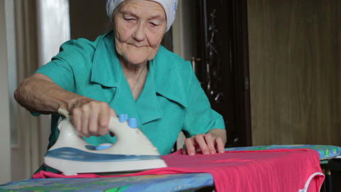 old woman ironing Stock Video Footage