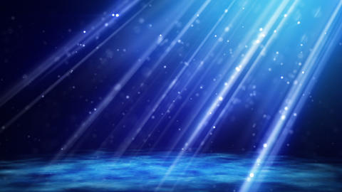 flying blue particles in light beams loop Animation
