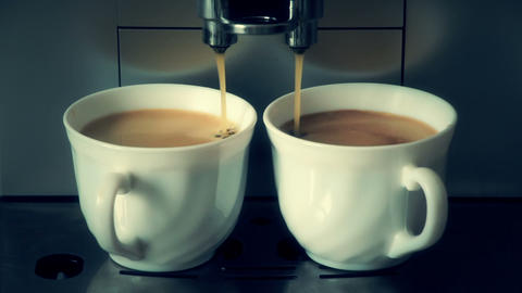 coffee machine pouring espresso in two cups Stock Video Footage