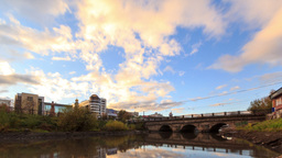 Clouds at sunset on background bridge. Time Lapse Stock Video Footage