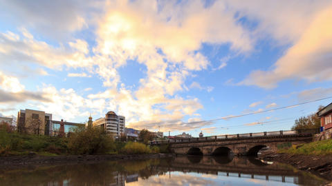 Clouds at sunset on background bridge. Time Lapse Footage