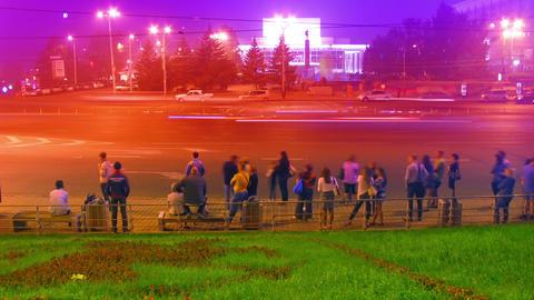 crowd at public transport stop urban night timelap Stock Video Footage