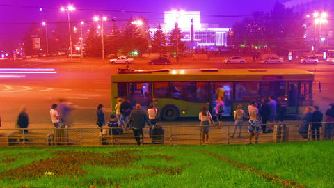 Crowd At Public Transport Stop Urban Night Timelap stock footage