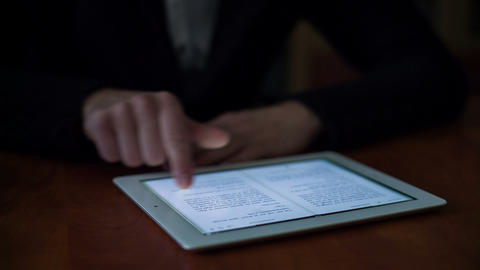 Young Man Using E-Reader Stock Video Footage