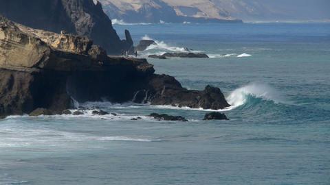 dangerous fishing in big waves 11096 Stock Video Footage