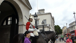 Tourists taking photo with horseguard London UK.(L Stock Video Footage