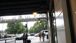 Crossing below Hungerford Bridge, London, UK.(LOND Stock Video Footage