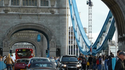 TRAFFIC MOVING TO & FRO LONDON TOWER BRIDGE, WITH  stock footage