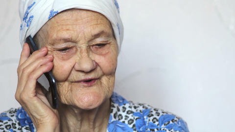portrait of old woman talking on smartphone Stock Video Footage