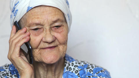 portrait of old woman talking on smartphone Footage