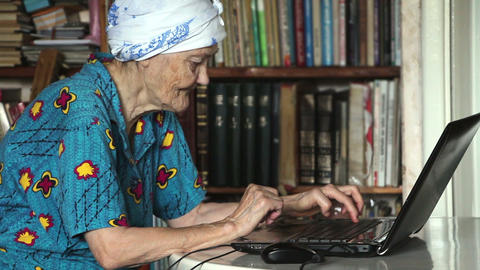 old woman using laptop Stock Video Footage