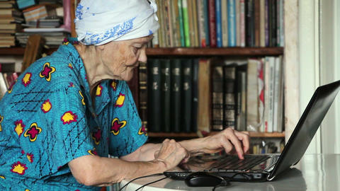 old woman using laptop Footage