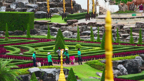 gardeners in famous Nong Nooch tropical garden Stock Video Footage