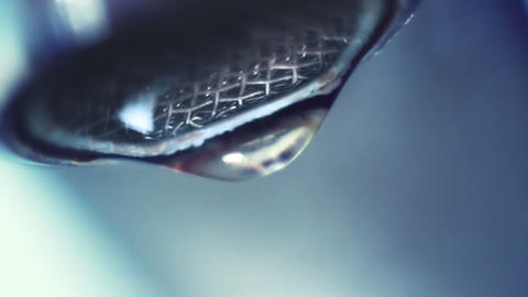 dropping faucet close-up slowmotion Footage