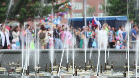 splashes of fountain water and crowd of people Stock Video Footage