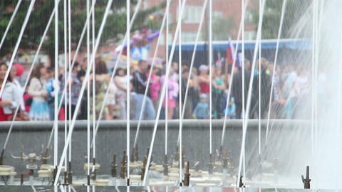 splashes of fountain water and crowd of people Footage