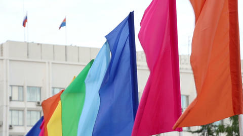 colorful flags against building Stock Video Footage