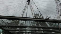 PAN DOWN FROM LONDON EYE WHEEL TO BASE SUPPORT, UK stock footage