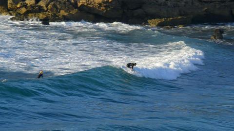 surfing at sundown 11105 Stock Video Footage