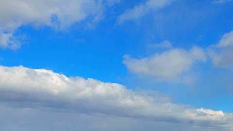 Clouds on a blue sky day Stock Video Footage