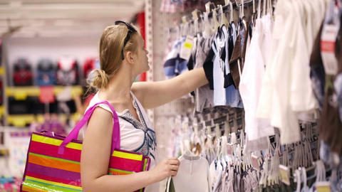 Mother shopping for childrens clothes Stock Video Footage
