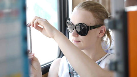 Woman taking pictures at her mobile on a bus Stock Video Footage