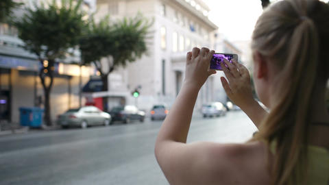 Woman photographing an urban street Stock Video Footage