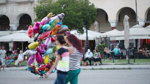 Balloon seller with colourful party balloons Footage