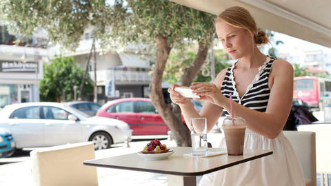 Attractive woman taking picture of a pastry on her Stock Video Footage