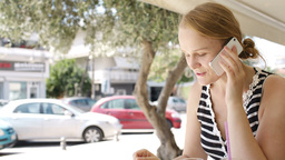Woman eating refreshments and using a mobile Stock Video Footage
