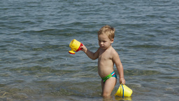 Adorable little boy playing in the sea Stock Video Footage
